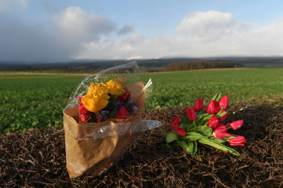 bouquet left in tribute by a roadside war memorial