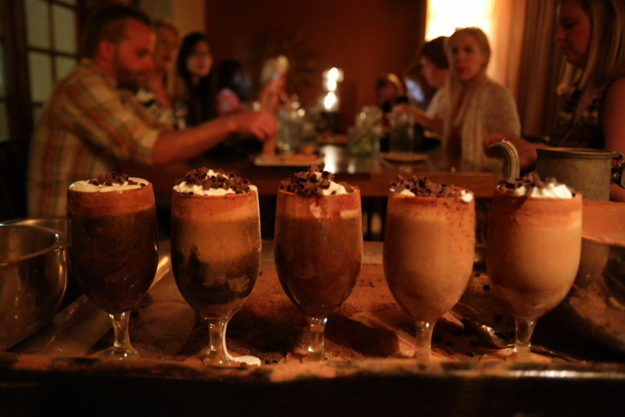 Mexican Coffee after the flaming ceremony that creates each glass. Flavored with liquor and topped with homemade whipped cream and chocolate shavings.